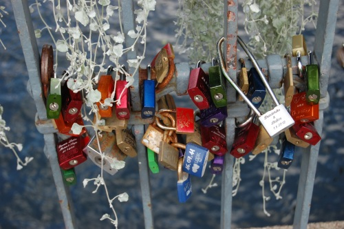In some European countries lovers place locks in strategic places with their names engraved on them - and throw away the key.