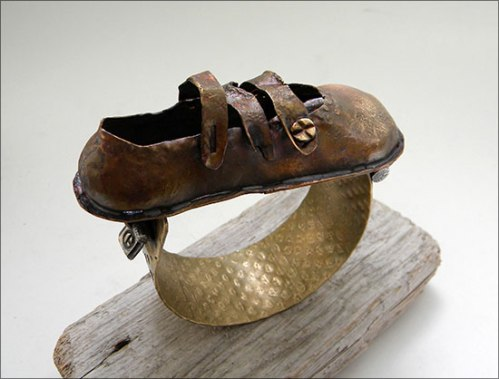 Bronze cuff of child's shoe from the wreckage of the Titanic