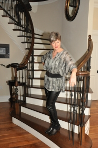 Emmy rocks this top by Linda Lundstrom and pleather pants by Melissa Nepton
