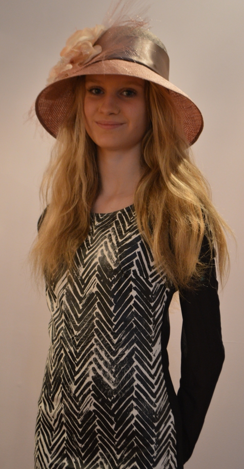 Here she is in vegan leather dress by Mink Pink and one of our hats