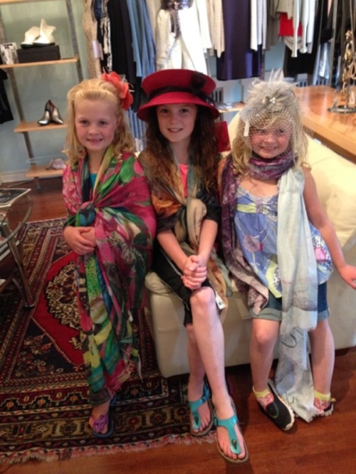 Twins and their older sister showing their mom how to rock some fashion.